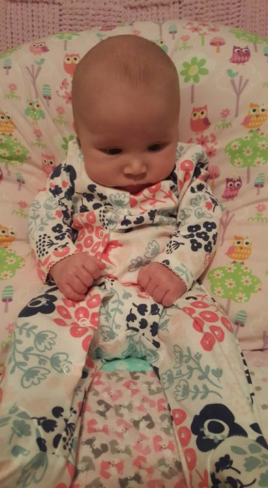 Can you find the baby amongst all the patterns? Someday she'll catch those feet of hers.